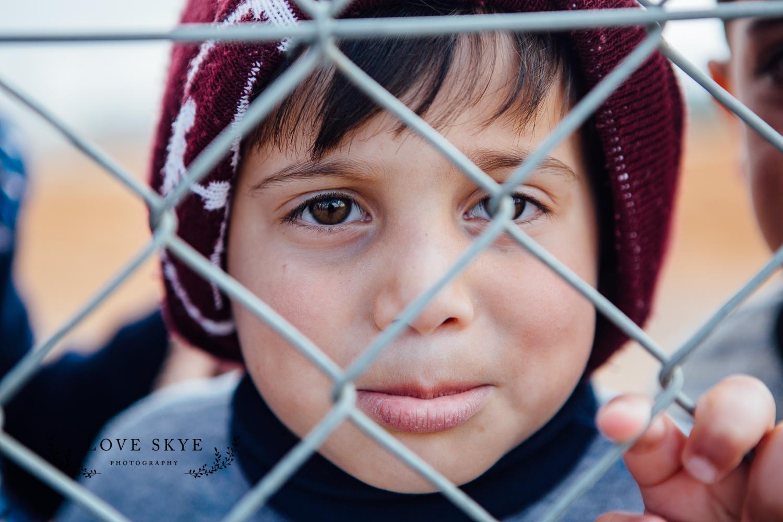 Boy fence Azraq-1