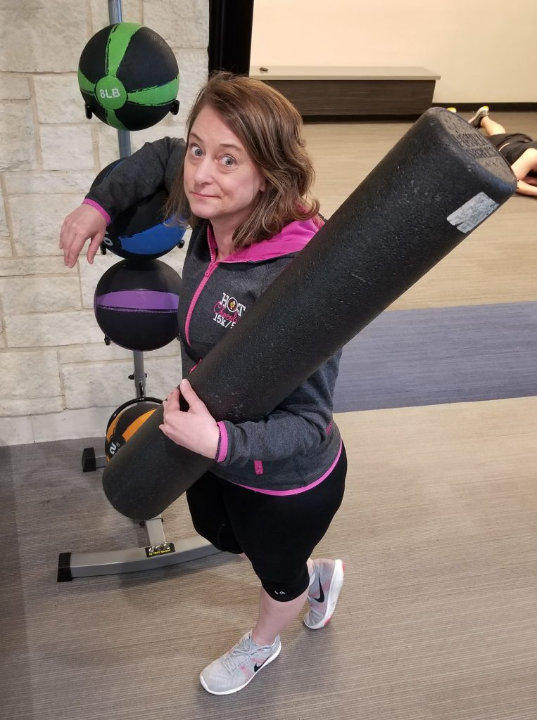 woman looking rueful with gym equipement